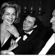 023 Lauren Bacall with Dirk Bogarde says %22smile for the camera,%22 awards ceremony, NYC, 1968