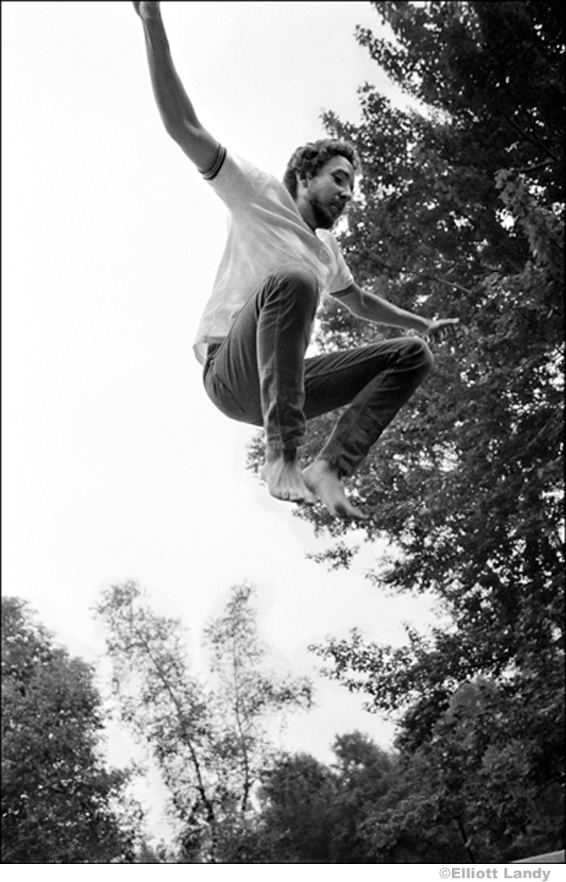 337 Bob Dylan, on trampoline at his Ohayo Mountain Rd. home, Woodstock, NY, 1969