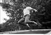 534 Bob Dylan, on trampoline at his Ohayo Mountain Rd. home, Woodstock, NY, 1969