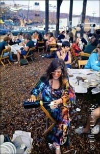 Janis Joplin in the performer's pavilion, Woodstock Festival, Bethel, NY, 1969. Photo By ©Elliott Landy, LandyVision Inc.